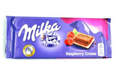 Шоколад Milka молочный с малиной